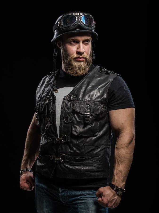 Portrait Handsome Bearded Biker Man in Leather Jacket and Helmet. Over Black Background stock images