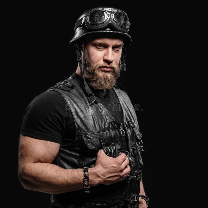 Portrait Handsome Bearded Biker Man in Leather Jacket and Helmet. Over Black Background stock photos