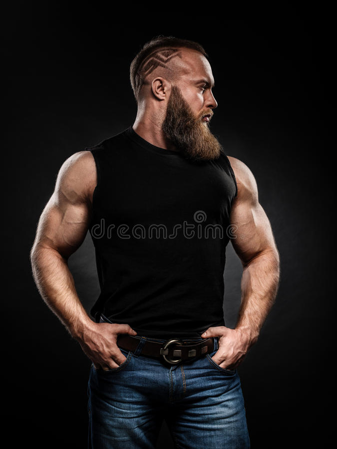 Portrait of handsome bearded man with fashionable hairstyle royalty free stock photography