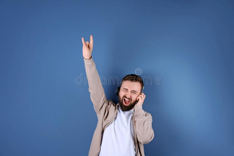 Portrait of handsome bearded man listening to music royalty free stock image