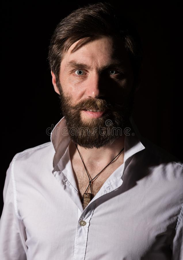 Portrait handsome bearded man, sexy guy on a dark background royalty free stock photo