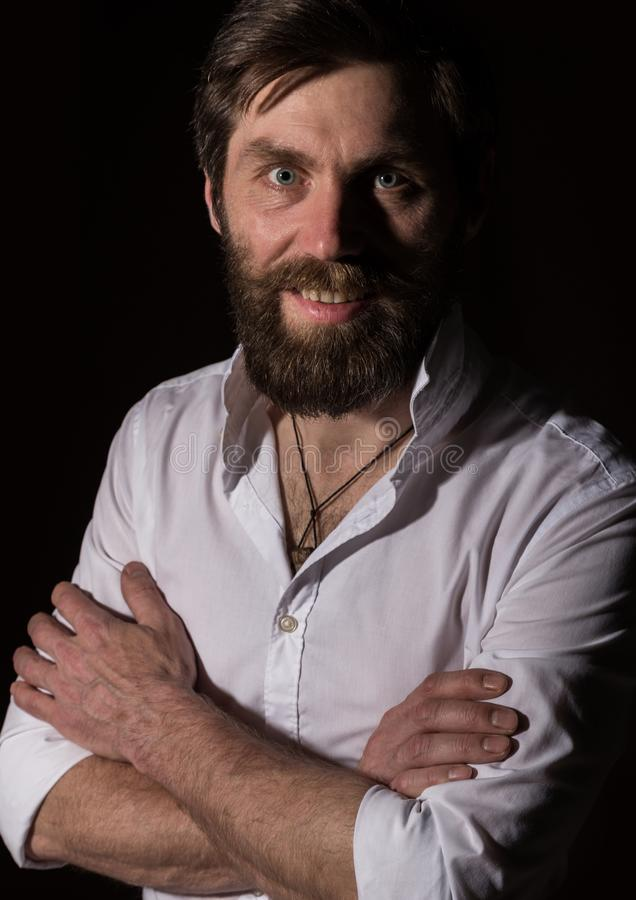 Portrait handsome bearded man, sexy guy on a dark background stock images