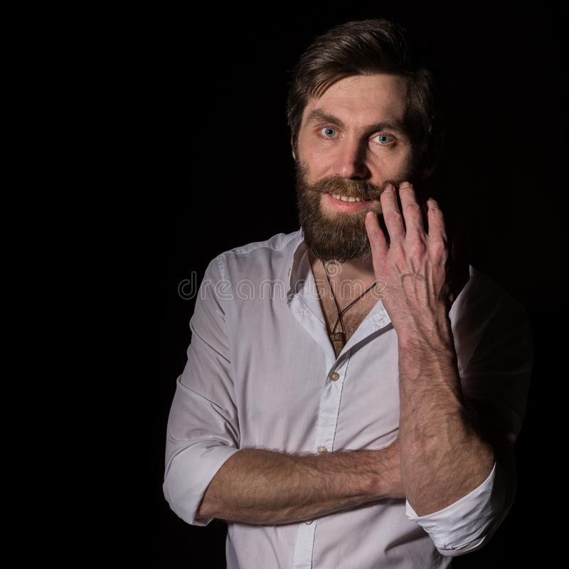 Portrait handsome bearded man, sexy guy on a dark background. free space for text stock photos