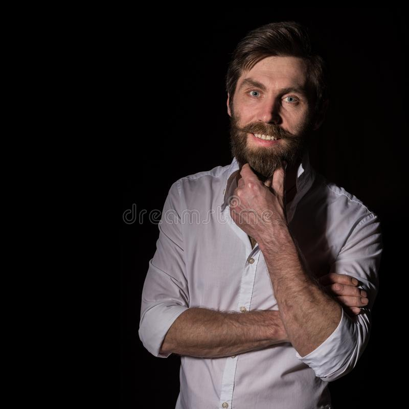 Portrait handsome bearded man, sexy guy on a dark background. free space for text royalty free stock photography