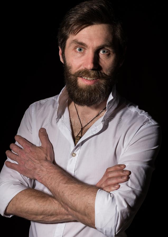 Portrait handsome bearded man, sexy guy on a dark background stock photography