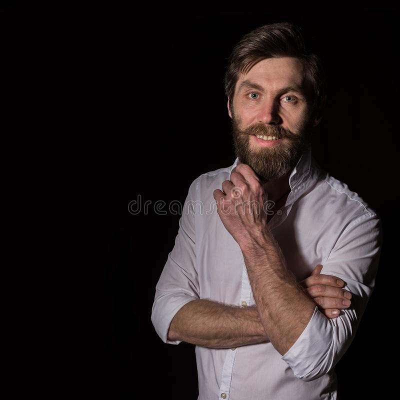 Portrait handsome bearded man, sexy guy on a dark background. free space for text stock photography
