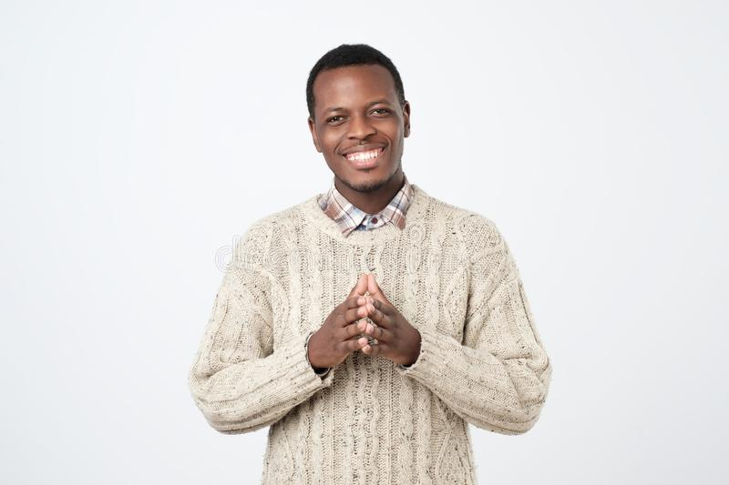 handsome black man in warm sweater isolated on a white background. Positive facial emotion royalty free stock images