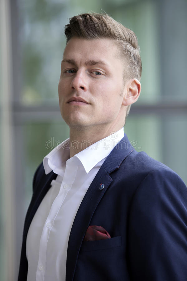 Portrait of handsome blond man looking at camera royalty free stock photos