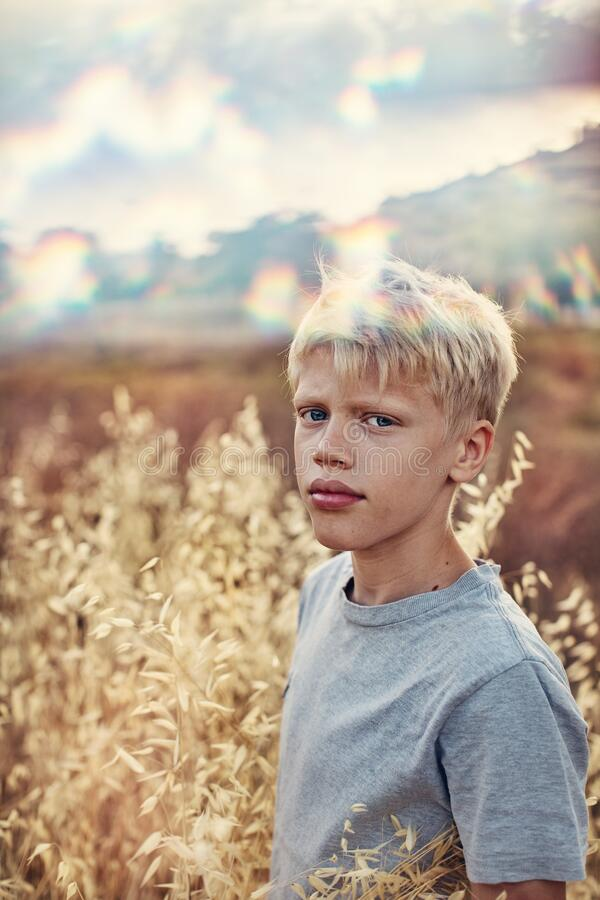 Portrait of a handsome boy 12 years  on a summer day . royalty free stock photos