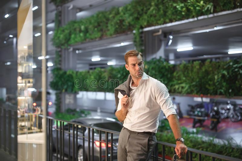 Portrait of a handsome business man in the evening city royalty free stock photos