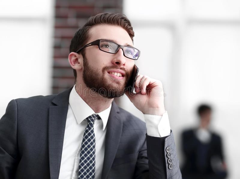 View of a Young attractive business man using smartphone royalty free stock image