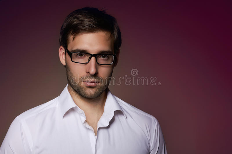 Portrait of handsome businesslike banker in eyeglasses. Portrait of handsome smartlooking businesslike Financier or agent or manager in eyeglasses and white royalty free stock photography
