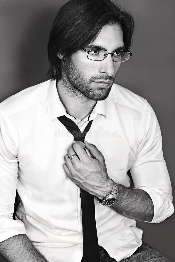 Portrait of handsome businesslike banker in eyeglasses and tie. Black and white portrait of handsome smartlooking intelligent businesslike Financier or agent or stock image