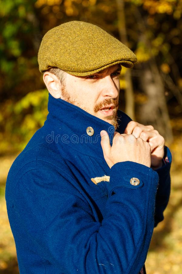 Portrait of young man in autumn forest stock photography