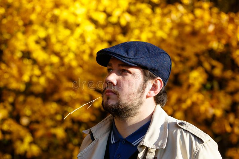 Portrait of young man in autumn forest royalty free stock photography