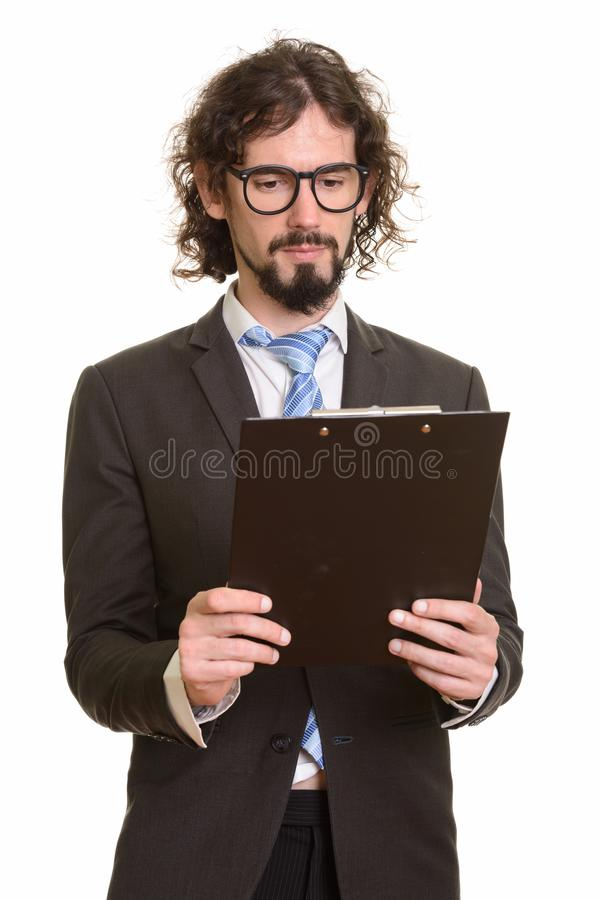 Portrait of handsome Caucasian businessman reading clipboard stock photography