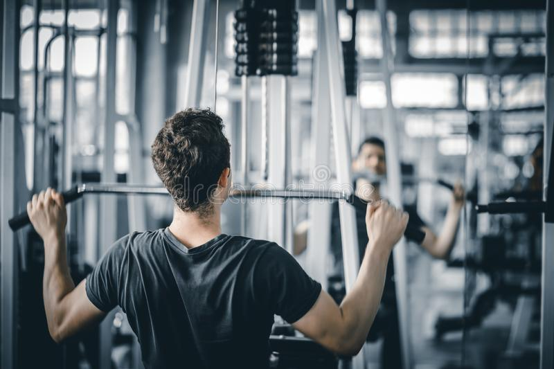 Portrait handsome caucasian young man healthy fitness doing exercise at indoor workout in gym. People beauty perfect body slim fitness man. Freedom happy and stock images