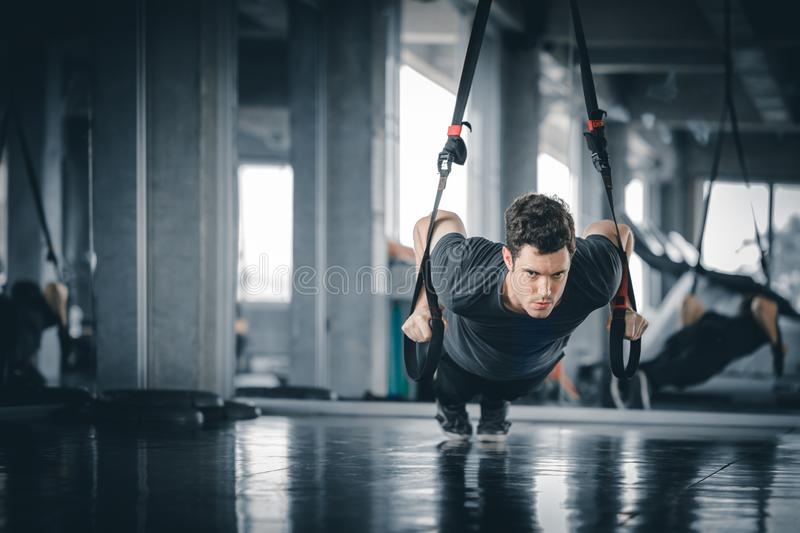 Portrait handsome caucasian young man healthy fitness doing push up at indoor workout in gym. People beauty perfect body slim fitness man. Freedom happy and royalty free stock photos