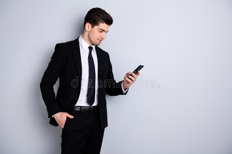 Portrait of handsome charming investor investment have conversation use modern technology get message solve work. Problems feel worried dressed modern classic royalty free stock photos