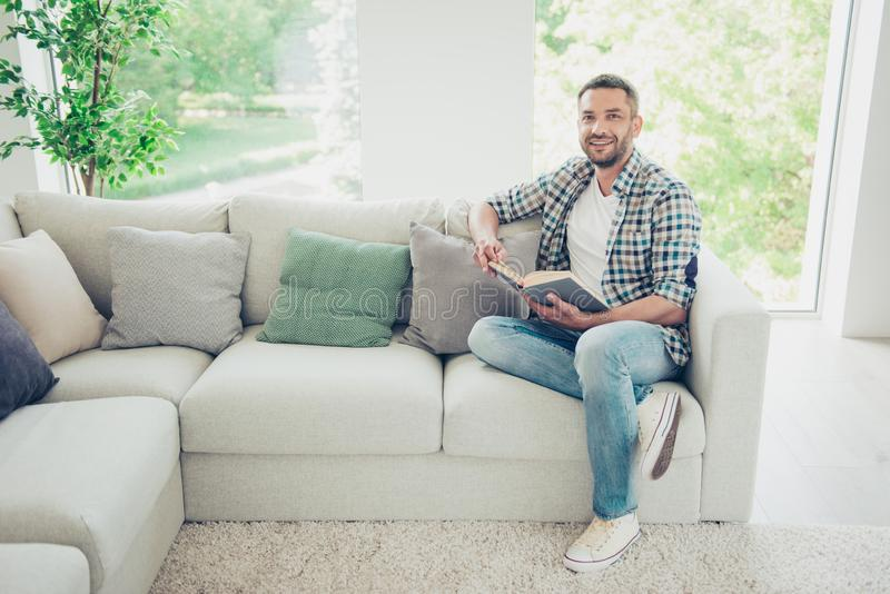 Portrait of handsome charming man expert sit library divan have studies inspired feel cheerful content hold hand bearded royalty free stock images