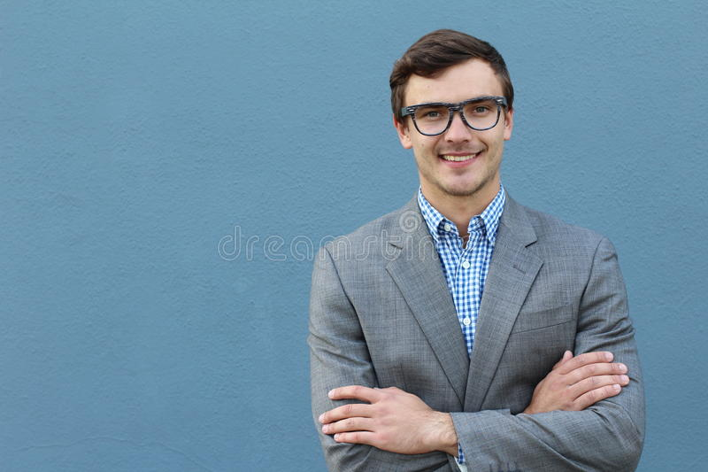 Portrait of handsome cheerful young smiling man in glasses royalty free stock photography