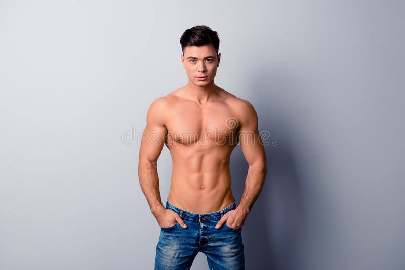 Portrait of handsome confident strong sporty man wearing jeans, royalty free stock photo