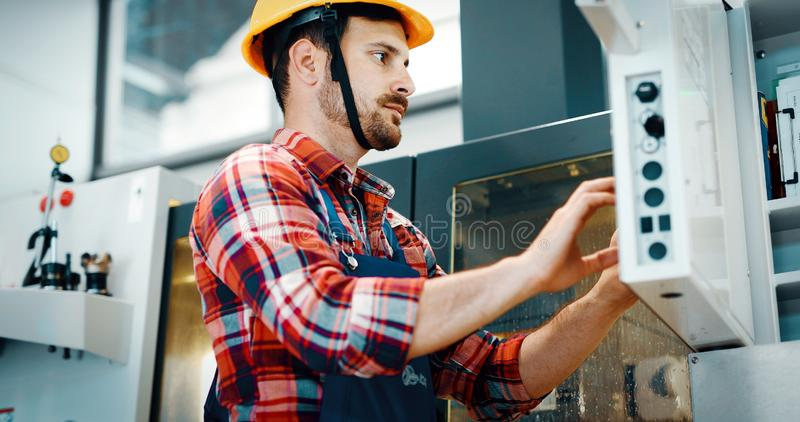 Portrait of an handsome engineer in a factory stock images
