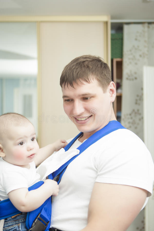 Download Portrait Of Handsome Father Holding Son In Sling Stock Photos - Image: 25883033