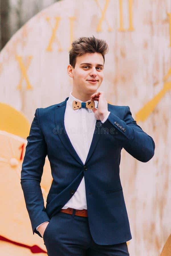 Portrait of handsome groom in bow tie stock photo