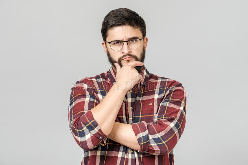 Portrait of handsome guy looking upside and shrugging his shoulders. Showing there`s nothing he can do with situation. Facial expressions royalty free stock images