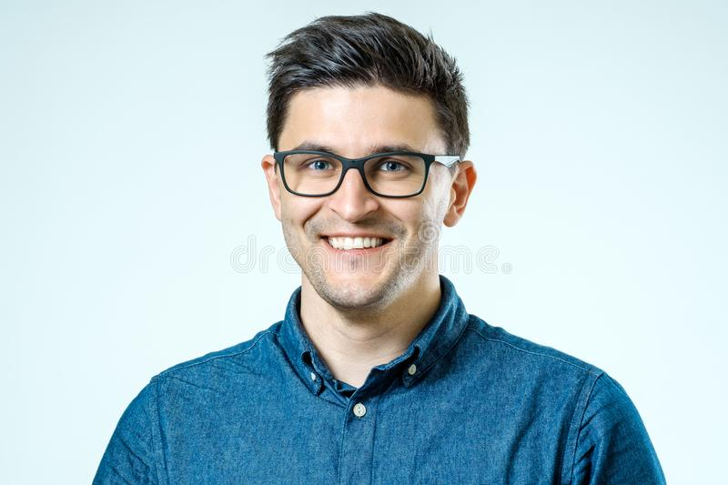 Portrait of handsome guy smiling at camera stock image