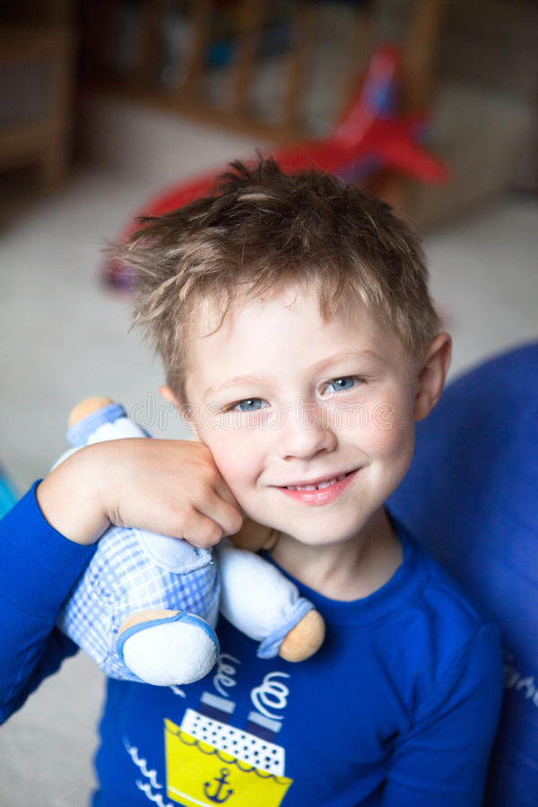 Portrait of a handsome little boy holding his toy royalty free stock photography
