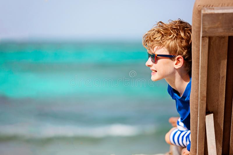 Kid at tropical vacation stock photo