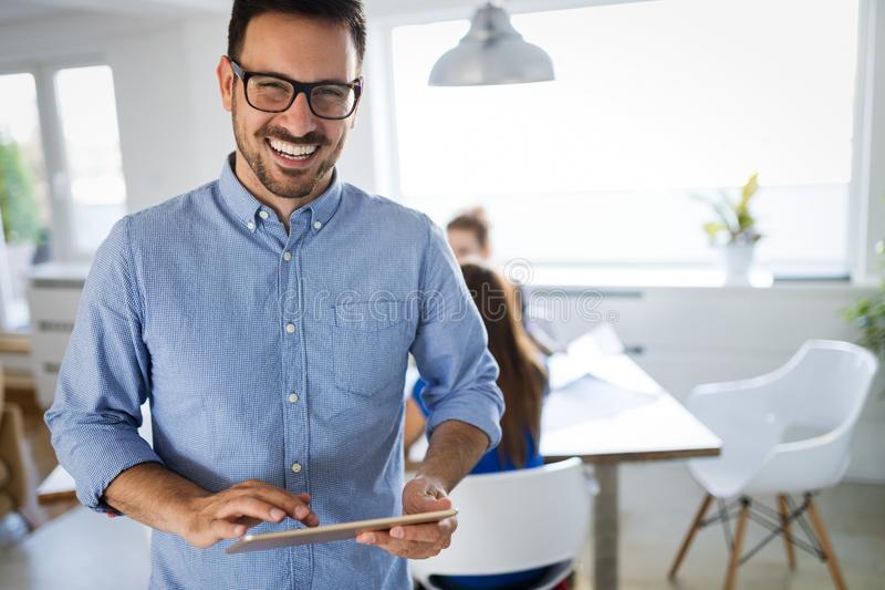 Portrait of handsome male company trainee in office royalty free stock photos