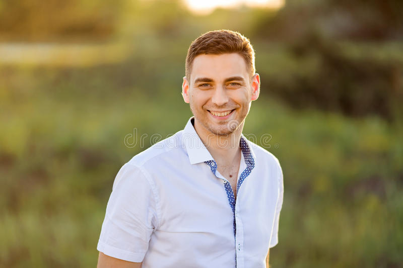 Portrait of Handsome Man against green nature background royalty free stock image