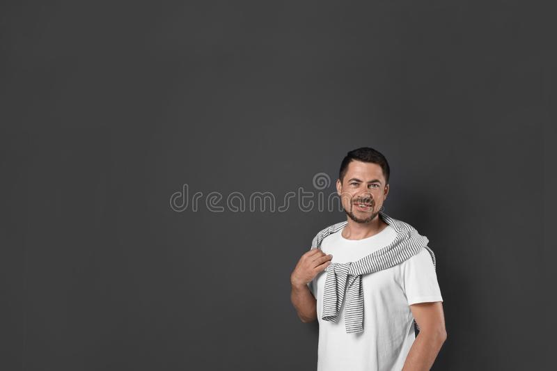 Portrait of handsome man on background. Space for text royalty free stock image