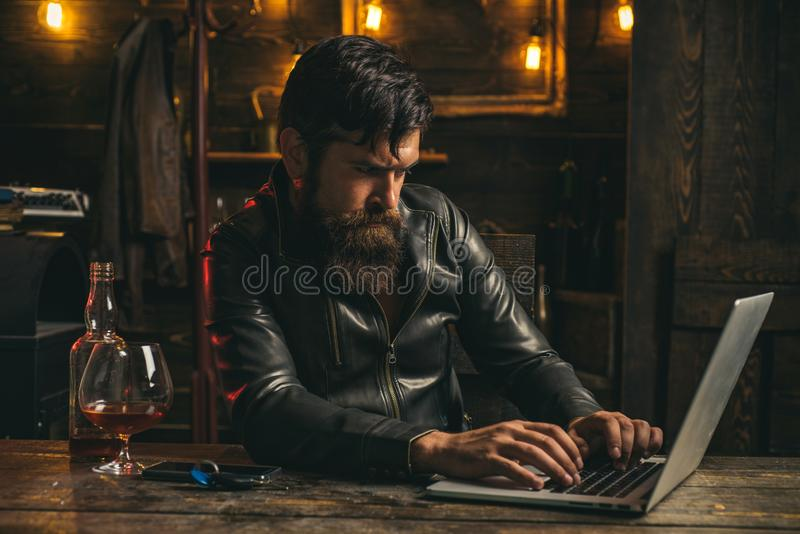 Portrait of a handsome man with beard. Brutality and masculine concept. Man with beard, biker in leather jacket. Macho royalty free stock photography
