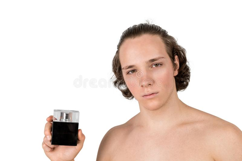 Portrait of handsome man with bottle of perfume on white background isolated royalty free stock photos
