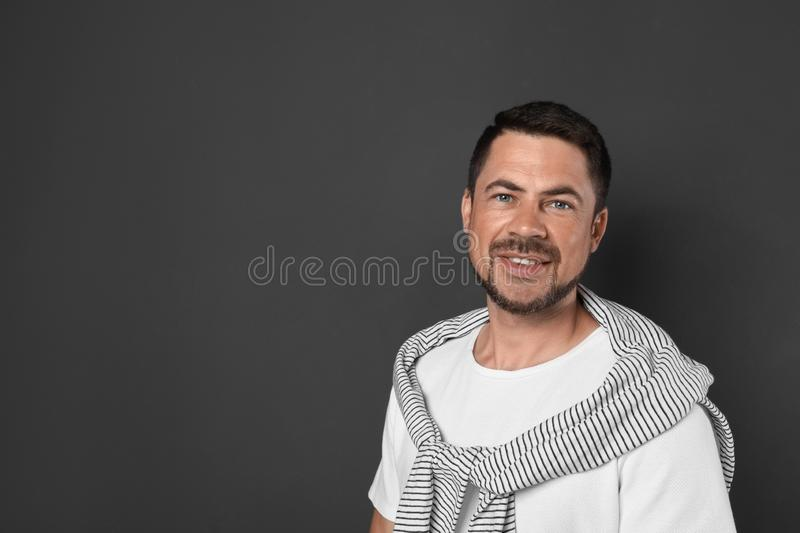 Portrait of handsome man on background. Space for text stock images
