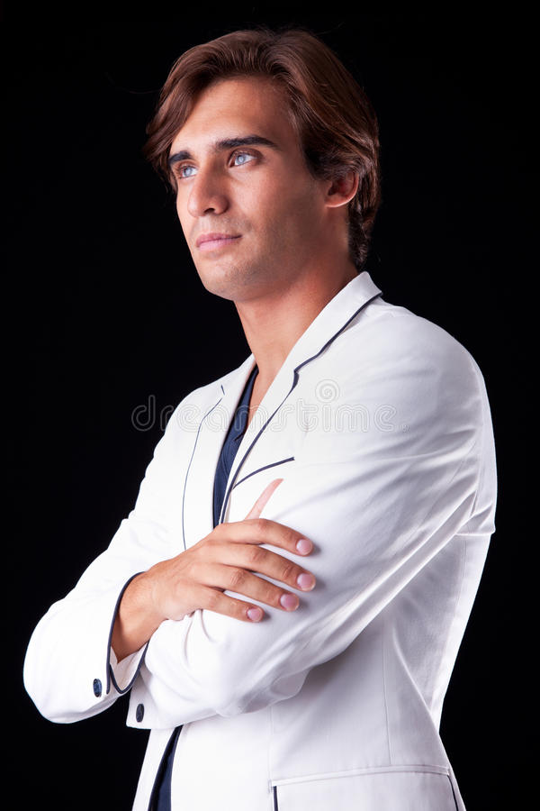 Portrait of a handsome man with his white coat stock photography