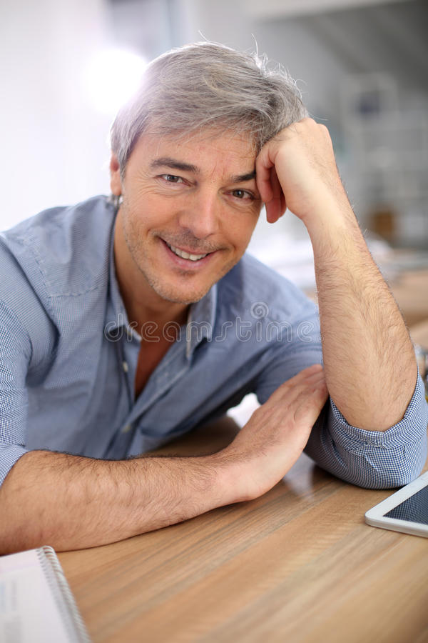Portrait of handsome man at office stock photo