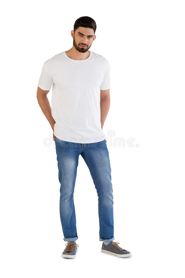 Handsome man posing against white background stock photo