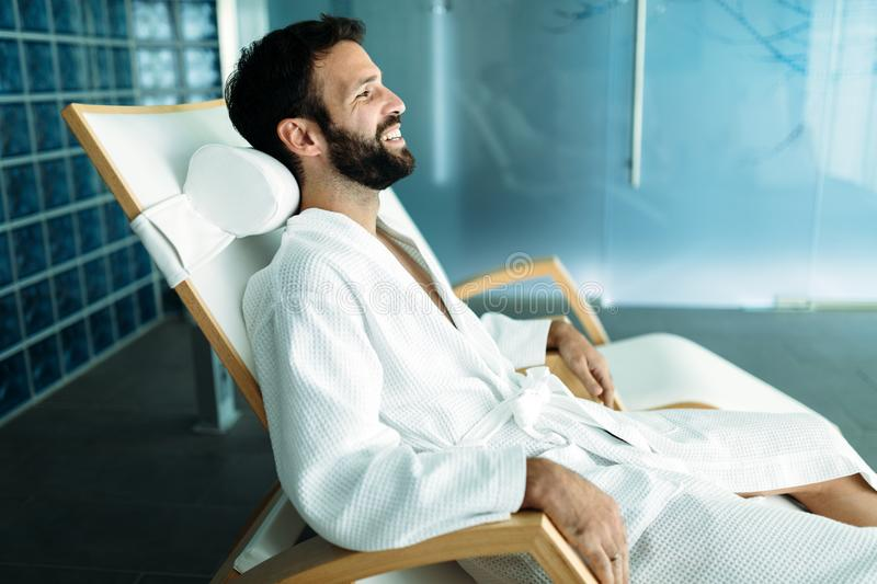 Portrait of handsome man relaxing in spa center stock images