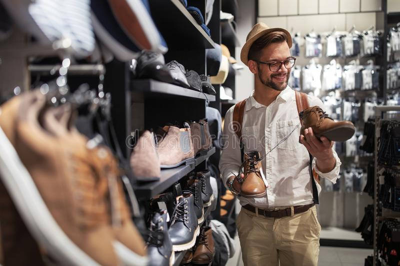 Portrait of a handsome man shopping for clothes at shop stock photos