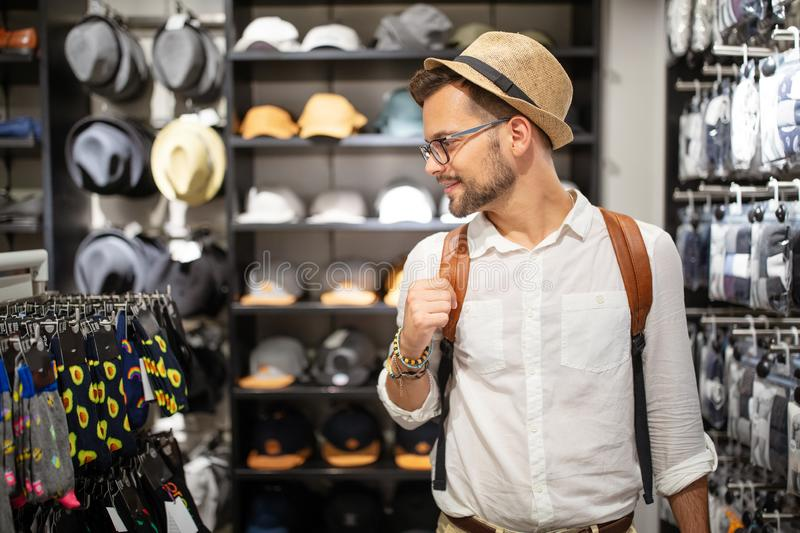 Portrait of a handsome man shopping for clothes at shop royalty free stock photography