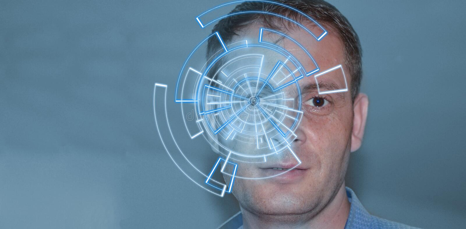 Portrait of handsome man with tech pattern on eye. Digital ID concept, eye recognition stock photo