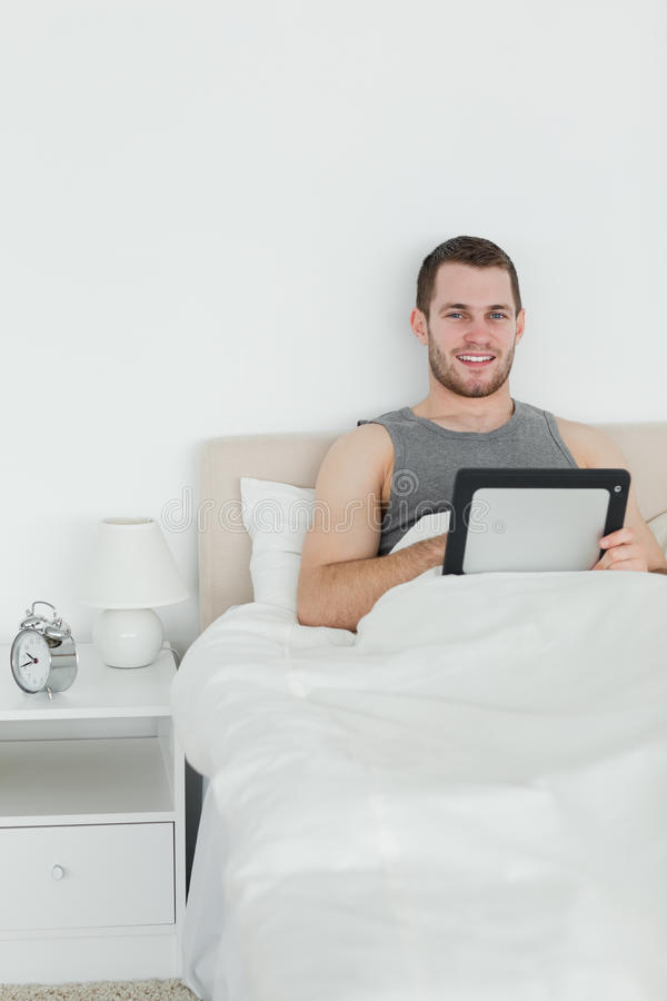 Download Portrait Of A Handsome Man Using A Tablet Computer Stock Photo - Image: 22143528