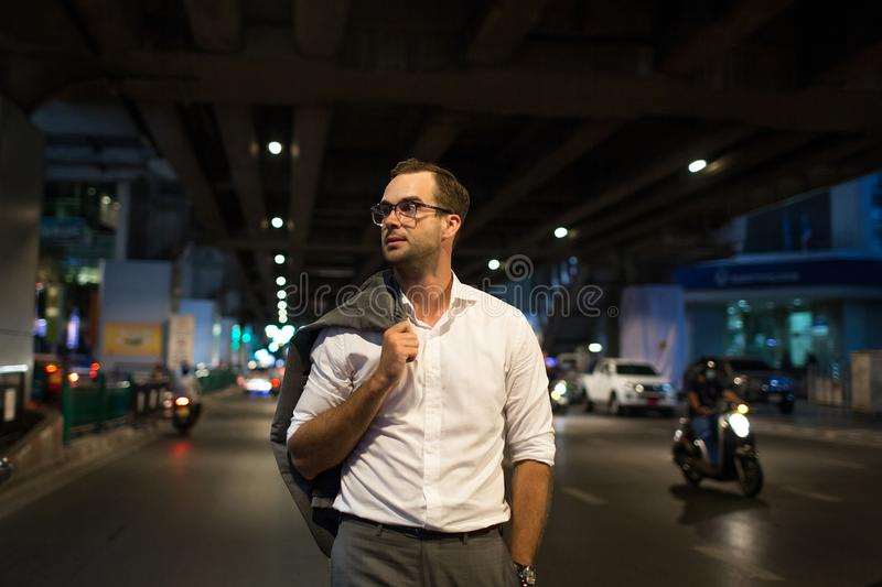 Portrait of a handsome man walking at night stock photo