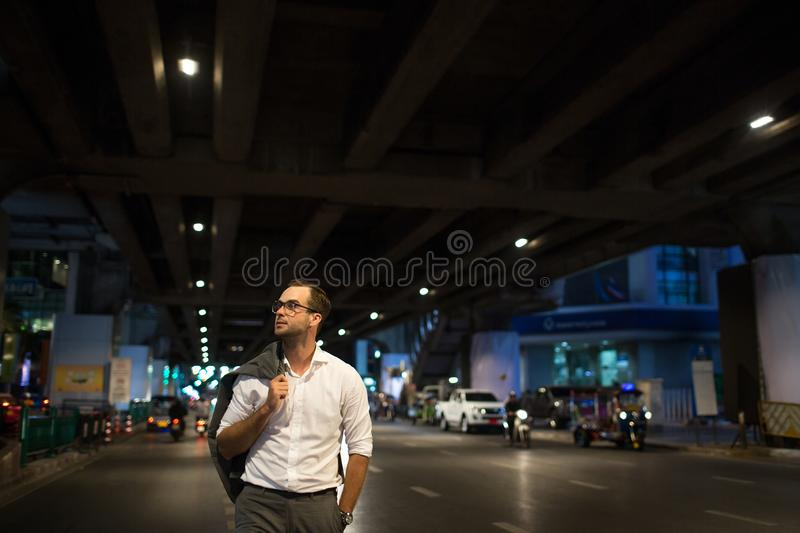 Portrait of a handsome man walking at night stock photography