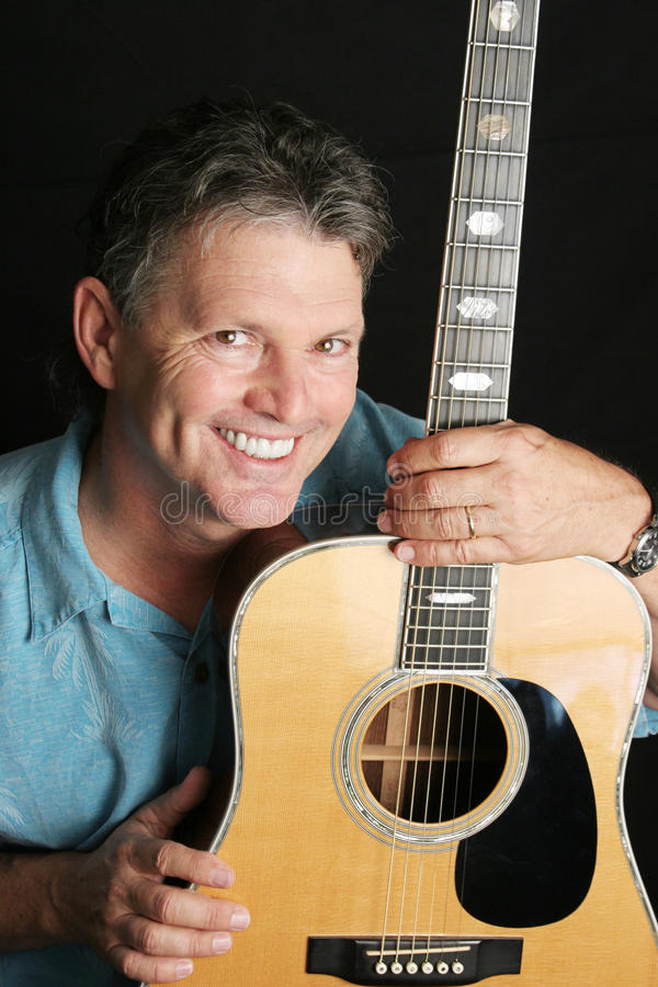 Portrait of Handsome Guitarist royalty free stock photography